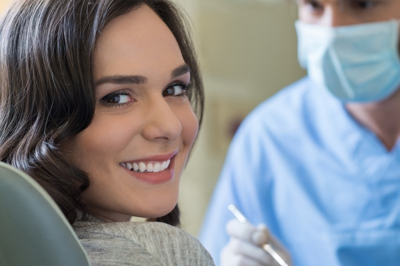 Woman sitting in a dentist's chair and smiling