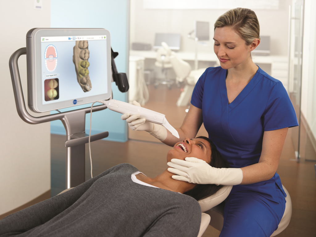 Dentist using the iTero Scanner